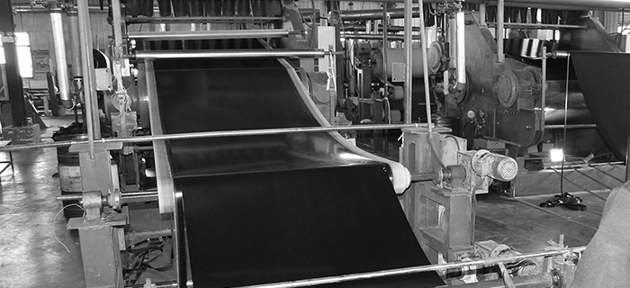 Nitrile black sheet rubber being produced on a rotocure - GCP Industrial Products