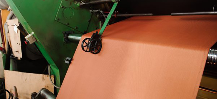 Orange National Silicone sheet rubber being produced on a rotocure - GCP Industrial Products