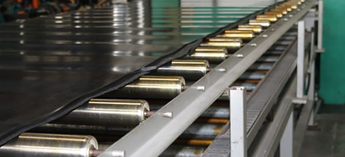 Sheet of EPDM black rubber on rollers lying flat - GCP Industrial Products
