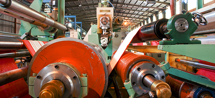Rubber lamination machine and its rollers in a large factory - GCP Industrial Products